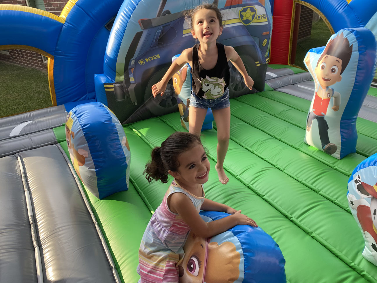 Kids playing in Paw Patrol Toddler Bounce House