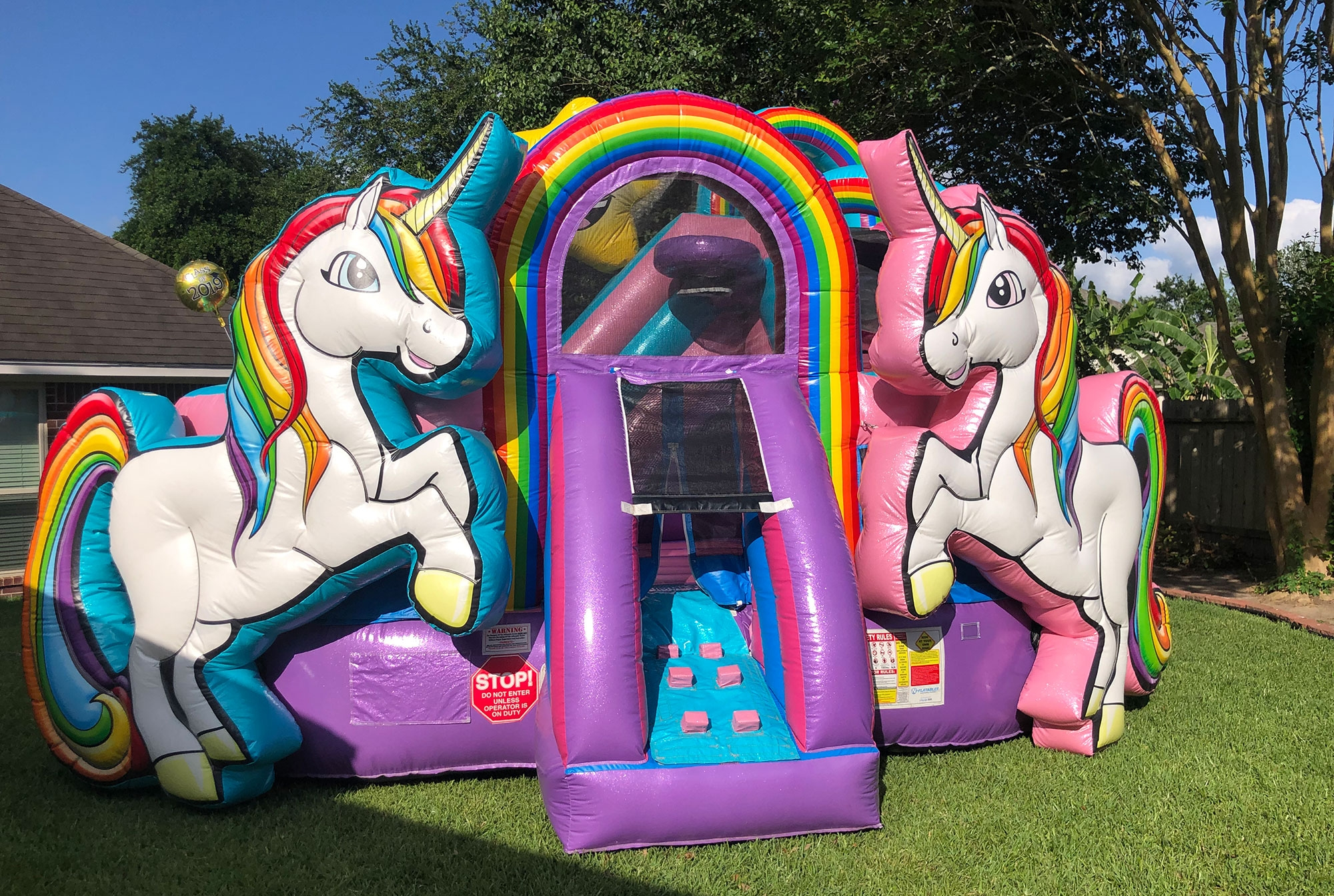 Unicorn bounce house rental entrance